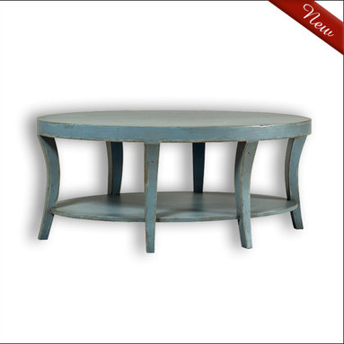 Liz Ann's Interior Design Boutique - The Cindala Coffee Table is a beautifully distressed oval table with curved tapered legs and a lower shelf.  It's available in a large selection of gorgeous hand applied finishes.  Shown in Vintage Blue.  Outside Dimensions: 48Wx20Hx30D.