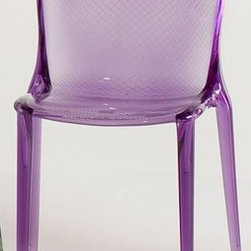 """Kartell - Thalya Chair - With smooth curvature throughout the whole piece, the Thalya Chair incorporates a strong graphic impact into the overall design. The surface features a fine pattern of crisscrossed lines incised into the seat and back for a look that's at once delicate and bold. With a selection of colors that range from earthy to vivid, the Thalya Chair is perfectly at home in the dining room, living room or on the patio. Features at a Glance: Thalya Chair Features: -Made of transparent or colored polycarbonate. -Delicate pattern of overlapping lines on seat and back. -Stackable up to five chairs high. -Suitable for indoor or outdoor use. -Made in Italy. Dimensions: -28.7"""" H x 18.9"""" W x 20.5"""" D. -Seat Height: 18.3"""". Quality: -In 2005, Kartell received accreditation for its Quality Management Systems according to the ISO 9001: 2000 standard. The attainment and preservation of this certification testifies to Kartell's commitment to high quality and continued research into higher levels of quality in company management systems. Helping the Environment: -Kartell products use a wide variety of plastic materials, thereby reducing the use of living organisms, such as trees, which are difficult and time-consuming to replace. -Most Kartell products are easily recycled and product components can be separated to elements made of a single material to simplify the recycling process. Plastic components also carry clear identification marks to aid correct separation of different plastic types for effective recycling. Care and Maintenance: -Kartell products are easy to clean and require only simple care to remain in excellent condition. . Order with Confidence: -Authentic Kartell products are guaranteed to be free from defects in materials and workmanship for a period of 12 months under normal use and under conditions for which the items were designated. -Should you discover shortly after receiving your Thalya Chair that parts are either damaged or missing, please call us """
