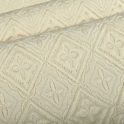 Rebecca Italian Upholstery Fabric in Cream - Rebecca Italian Upholstery Fabric in Cream has a quilted traditional geometric pattern with a feminine feel and neutral color. his fabric has a soft texture that creates a cozy feel perfect for upholstering sofas and chairs, or for creating custom bedding. Made in Italy from a blend of 26% cotton, 22% viscose, and 52% polyester. Width: 54″; Repeat: 2 3/4″H; 3 1/4″V