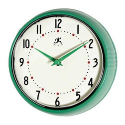 Green Retro Round Metal Wall Clock - I adore this retro metal kitchen clock. The green hands are a fun touch, and I love the retro font of the numbers.