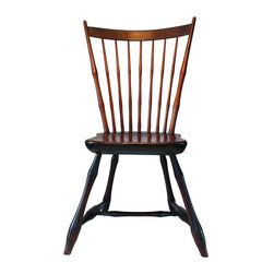 Used Primitive Country Sheraton Windsor Chair - Original 19th century Windsor chair. The rich dark patina and the heft of the seat is testament to it's history. New England style tapered legs. Obviously hand hewn, the spindles are slightly thicker at the bottom where the wood-worker held the stick for shaving. This chair has a beautiful sheen from years of use and polishing. Truly beautiful!    Item stored in our Oak Hill, upstate New York, warehouse, but if purchased by a local NYC client the seller can arrange to bring it to the Brooklyn shop for pick-up.