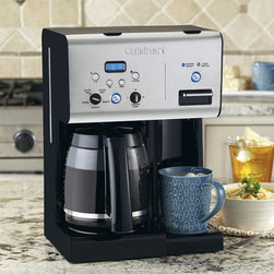 "Frontgate - Cuisinart Coffee Plus Programmable Coffee Maker - 12-cup carafe equipped with a drip-free pour spout and a comfortable handle. Fully automatic system with auto-on and auto shutoff, self-clean function and 1-4 cup setting. Blue backlit LCD with digital clock. Carafe temperature control offers a heater plate with high, medium, and low settings to keep coffee at the temperature you prefer. Brew Pause™ feature lets you enjoy a cup of coffee before the brewing cycle has finished. Fresh, delicious coffee is only the beginning with our Cuisinart Coffee Plus Programmable Coffee Maker with Hot Water System. Complete with many favorite features, like 24-hour programmability, carafe temperature control, Brew Pause™, and the ultra-convenient hot water system that operates parallel to the coffee maker. You're never more than a minute away from enjoying your favorite coffee, tea, hot cocoa, or soup. . . . . . Charcoal water filter and gold tone filter remove impurities that can alter the taste of your beverages. Hot water on demand heats up fast to let you enjoy oatmeal, soup, tea, or cocoa any time you like. Easy to use indicator lights let you know when water is hot and ready to dispense, and when it's time to refill. Removable drip tray leaves you plenty of room for tall travel mugs. Separate hot water system has its own power button and 54-ounce water reservoir; operates independently or at the same time as the coffeemaker. Safety feature prevents hot water from being dispensed. All materials that come in contact with water or coffee are BPA Free. Limited 3-Year Warranty. 27"" cord."