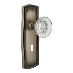 Nostalgic - Nostalgic Passage-Prairie Plate-Round Clear Crystal Knob-Antique Pewter - The quiet, discerning restraint of the Prairie Plate in antique pewter evokes a spirit reminiscent of the Craftsman style. Adding our Round Clear Crystal Knob, which features a circular shape that magnifies the beautiful facets underneath, only serves to bring the past alive. All Nostalgic Warehouse knobs are mounted on a solid (not plated) forged brass base for durability and beauty.