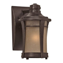 Quoizel Lighting - 10-1/2-inch Outdoor Wall Light - HY8407IB - This outdoor wall light presents a modern style, perfect for welcoming guests and visitors to your doorstep. The cream-linen glass exudes an alluring amber glow when lit. The imperial bronze cage has a contemporary style courtesy of four tapered pieces that connect the brim to the bottom. Stands 10-1/2 inches tall. Takes (1) 100-watt incandescent A19 bulb(s). Bulb(s) sold separately. ETL listed. Wet location rated.