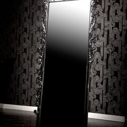 drg - Standing Baroque Mirror - This extremely tall mirror emulates rock-star style and glamor. Featuring an ornately carved Baroque frame painted in a shiny black finish, it mixes elegance with edginess, accumulating in a fabulously unique mirror. Its sheer height means that it brings a certain drama and presence to your house that not many mirrors can match. BLACK 32 IN W 3 IN D 89 IN H 63 LBS