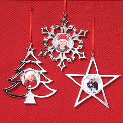 """Exposures - Silver Plated Ornaments Set of 3 - Overview Give your tree a warm, personal feel by adding a few familiar faces inside these silver plated photo ornaments. Fit any decor, so you can split up the set for teacher, babysitter or neighbor gifts.  Features High quality metal photo ornaments  Set of one each: snowflake, star and tree Red hanging ribbon   Specifications  Each ornament holds one 1 1/2"""" diameter photo Star ornament measures 5 1/4"""" wide by 5 1/4"""" high  Snowflake ornament measures 5 1/4"""" wide by 5 1/4"""" high  Tree ornament measures 5 1/2"""" wide by 5"""" high"""