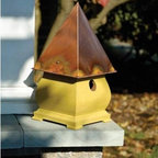 """SoHo French Mustard Crackle Birdhouse - This birdhouse reminds me of """"I'm a little teapot short and stout"""" with it's cute squat body. I like it because it has feet so can be placed on a table or the edge of a deck. If you have loud dogs like I do you can also get a stake and put it out of prying mouths' way."""