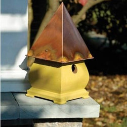 "SoHo French Mustard Crackle Birdhouse - This birdhouse reminds me of ""I'm a little teapot short and stout"" with it's cute squat body. I like it because it has feet so can be placed on a table or the edge of a deck. If you have loud dogs like I do you can also get a stake and put it out of prying mouths' way."