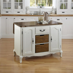 HomeStyles - Oak and Rubbed White Kitchen Island - The Kitchen Island is constructed of hardwood solids and engineered wood in a distressed oak and heavily rubbed white finish. The distressed oak features several distressing techniques such as worm holes, fly specking, and small indentations. Features include two large cabinet doors with adjustable shelves, two large rattan wicker baskets for storage, and one storage drawer. Design features include shaped carved proud legs, corner peg accents, and detailed brass hardware. Bottom of wicker baskets are removable. Depth of top is 37 inches with leaf extended. Assembly required. 48 in. W x 25 in. D x 36 in. H