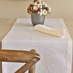 """Origin Crafts - Serenite white linen table runners - Serenite White Linen Table Runners 100% linen. We have a wide collection of 100% linen table runners to suit your decor style, ranging from solid to jacquard,casual to luxurious and contemporary to French country chic. They can be placed along the table or across it, depending on the look that you want to achieve. Beautiful hemstitched edges highlight the sophistication of a linen runner and make it an attractive element in any interior. Dimensions (in): 20"""" x 67"""" 20"""" x 90"""" By Linen Way - Linen Way is a family-owned wholesale business that sells the finest home textiles, handpicked from around the world. Linen Way offers inspirational products for your life and home in traditional and modern designs. Estimated Delivery Time 1-2 Weeks. Please be aware that some products are handmade and unique therefore there may be slight variations in each individual product."""