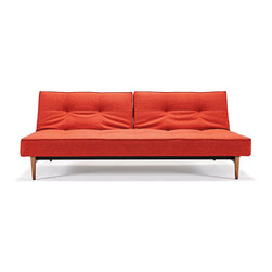 Divi Sofa in Orange - Multifunctional and completely modern, the Divi Sofa is a study in playfulness and simple, modern design. Convertible to a full-sized bed, the sofa has a 7-inch thick mattress, powder-coated metal frame, and walnut wood legs. Perfect for living rooms and guest rooms that need a hard-wearing, sophisticated, and versatile piece of furniture that's good for entertaining and for sleeping.
