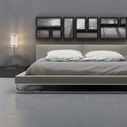 Modloft - 212 Modern Furniture Warehouse Top Products - The Chelsea bed is a fine example of skilled artisan handwork and sophisticated design. Distinguishing this bed is the neatly tailored headboard, with middle seam line and clean side folds. The firm leather upholstered headboard and frame rests atop a rounded polished steel base. Flexible European wood slats sit inside the bed frame and allow air to circulate beneath the mattress. No box spring necessary; simply use an innerspring or latex foam mattress. Platform height measures 10 inches. Available in California-King, Standard King, Queen, and Full sizes. Colors available include White, Plum, and Dusty Grey bonded leathers. Steel frame construction. Assembly required. Mattress not included. Imported.