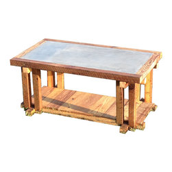 The Rusted Nail LLC - Concrete Coffee Table - Add a rustic appeal to any outdoor or indoor space with this unique coffee table, constructed from reclaimed barn wood. The table's top is formed from steel mesh with a layer of concrete that's then sanded and polished smooth. A water-based sealer over the entire piece ensures its longevity.