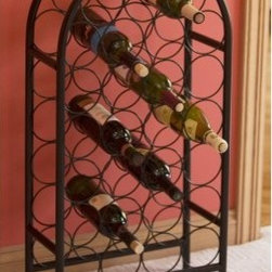 Old Dutch 27-Bottle Classic Floor Standing Wine Rack - The 27-Bottle Classic Metal Wine Rack is a stylish arched wine rack that's perfect for storing your favorite red and white wines. This wine rack is constructed from sturdy tubular steel for a long life. This rack is finished with a durable matte black powder-coat finish that blends beautifully with any decor. The open design allows you to easily read bottle labels. Holds up to 27 bottles of wine. This product requires some simple minor assembly. About Old Dutch InternationalFamous for their copperware Old Dutch International Ltd. has been supplying the best in imported housewares and giftware to fine retailers throughout America since 1950. They offer a large assortment of housewares including baker's racks trivets and pot racks in materials like chrome colorful enamel and stainless steel. Other product lines include wine racks serving trays specialty cookware clocks and other home accessories. Old Dutch warehouses and distributes their products from a 30 000 square foot facility in Saddle Brook N.J.