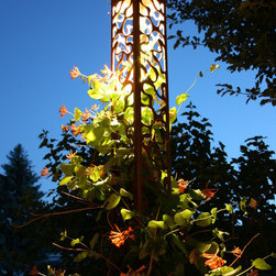 Attraction Lights overview - Lava Lamp Obelisk (6x6x70) used as trellis for Honeysuckle Vine.  Photo by Lyle Braund