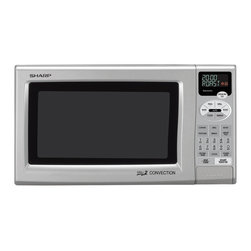 Sharp - 0.9 Cu.Ft. 900W -Silver Convection/Grill with Stainless Interior - 900-watt convection microwave oven (top and bottom heater = 1500 watts)|0.9 cu. ft. capacity with 12.75 inch Carousel turntable|Stainless steel interior with light|2-line, 12-digit interactive display|Custom Help to program child lock and language/weight options|AutoBake, AutoPizza, AutoGrill, AutoRoast, AutoCook and AutoDefrost|35 pre-set menu options and popcorn setting|Reheat provides perfect reheating every time - no cold spots!|Minute Plus gives one more minute of high cooking at a touch|Programmable 4 stage cooking with 11 variable power levels|  microwave| oven| convection| grill| 2| 0.9| cu| ft| 900w| 900-watt| 900-watts| 900| w| watt| watts| turntable| stainless| steel| interior  Package Contents: convection microwave oven|turntable|turntable support|warranty|manual  This item cannot be shipped to APO/FPO addresses  Sharp will no longer take back any Sharp product as a DOA.