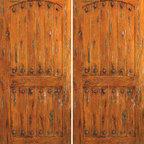 """Exterior Double Door, Knotty Alder, Southwest Home, Clavos - SKU#SW-62_2BrandAAWDoor TypeExteriorManufacturer CollectionWestern-Santa Fe Entry DoorsDoor ModelDoor MaterialWoodWoodgrainKnotty AlderVeneerPrice1640Door Size Options2(30"""") x 80"""" (5'-0"""" x 6'-8"""")  $02(32"""") x 80"""" (5'-4"""" x 6'-8"""")  $02(36"""") x 80"""" (6'-0"""" x 6'-8"""")  +$402(42"""") x 80"""" (7'-0"""" x 6'-8"""")  +$2202(36"""") x 84"""" (6'-0"""" x 7'-0"""")  +$4602(30"""") x 96"""" (5'-0"""" x 8'-0"""")  +$6002(32"""") x 96"""" (5'-4"""" x 8'-0"""")  +$6002(36"""") x 96"""" (6'-0"""" x 8'-0"""")  +$6602(42"""") x 96"""" (7'-0"""" x 8'-0"""")  +$1060Core TypeSolidDoor StyleRusticDoor Lite StyleDoor Panel StyleHome Style MatchingSouthwest , Log , Pueblo , WesternDoor ConstructionTrue Stile and RailPrehanging OptionsPrehung , SlabPrehung ConfigurationDouble DoorDoor Thickness (Inches)1.75Glass Thickness (Inches)Glass TypeGlass CamingGlass FeaturesGlass StyleGlass TextureGlass ObscurityDoor FeaturesDoor ApprovalsDoor FinishesDoor AccessoriesClavosWeight (lbs)680Crating Size25"""" (w)x 108"""" (l)x 52"""" (h)Lead TimeSlab Doors: 7 daysPrehung:14 daysPrefinished, PreHung:21 daysWarranty1 Year Limited Manufacturer WarrantyHere you can download warranty PDF document."""