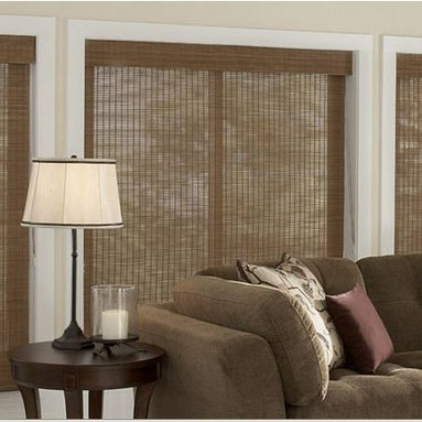 Family Room Inspiration - Woven Wood Shades add textural interest to any room. Bring a touch of the outdoors inside with these shades that can be dressed up or down; add edge binding for a more finished look. Tighter weaves provide increased privacy, light control and energy efficiency.