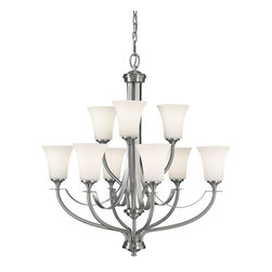 Murray Feiss - Murray Feiss Barrington Transitional Chandelier X-SB3+6/3522F - This Murray Feiss chandelier features clean, updated finishes blended with subtle traditional styling for a look that is sure to please. The crisp tones of the Brushed Steel finish highlight the clean lines and style while the two tiers of nine inverted opal etched glass shades compliment the look.