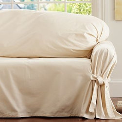 """Twill Tie-Arm Loose-Fit Slipcover, Small Sofa, Parchment - Detailed with ties at each corner for a relaxed yet finished look, our Tie-Arm Loose-fit Slipcover allows you to reinvent your space with one simple update. Made of pure cotton. Protects furniture from the rigors of everyday family life. Detailed with front and back ties that adjust for a custom fit. Designed to fit both T-cushion and square-cushion sofas. Our slipcovers are designed to fit a wide variety of furniture styles. As a result, there may be more fabric than you need. Easy to care for and simple to store. To order fabric swatches free of charge, click """"request swatches"""" below. Watch a video on how to put on a {{link path='/pages/popups/loose-tie_video_popup.html?cm_sp=Video_PIP-_-PBQUALITY-_-TIEARM_LOOSEFITSLIPCOVER' class='popup' width='420' height='300'}}Tie-Arm Loose-Fit Slipcover{{/link}}. Machine wash or spot clean. Catalog / Internet only. Imported."""