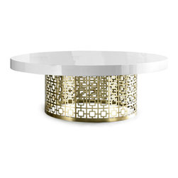Nixon Cocktail Table, Gloss White Lacquer and Brushed Brass - The base for every well-styled coffee table is a very cool table, no? Start it off right with the Nixon cocktail table from Jonathan Adler. It's a splurge to be sure, but seriously, look at all that brass and lacquer gorgeousness!
