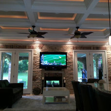 Traditional Basement by K-Build