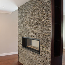Modern Indoor Fireplaces by Buildya Development Ltd.