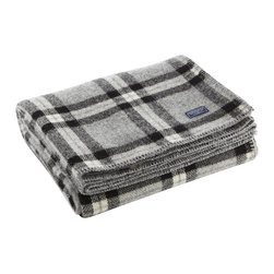 Faribault Mill - Soho Wool Throw - Gray/Black Plaid - Some of the best things come from finding use in what would otherwise be discarded. That's what happened at Faribault Woolen Mill prior to its closing in 2008. With remnant yarn from dwindling inventory, the Soho throw (short for stuff-on-hand-only) was made and it has become a mill favorite since the mill's reopening.We are proud to keep this design alive in a variety of colorways that give a layer of comfort and tradition to any home décor. 100% wool. Dry clean only. Made in America.