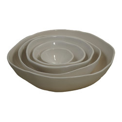 5-Piece Nesting Bowl Set - Nested together, this handmade, five-piece bowl set looks like an elegant flower. Spread out around your table, they form an overall feeling of unique craftsmanship and quality design. A durable material, the stoneware clay is practical and lovely.