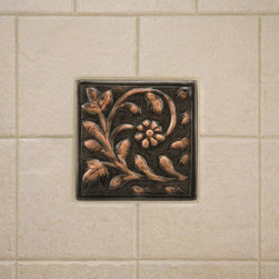 Solid Copper Wall Tile with Floral Design - Create a unique and customized space with this copper wall tile. It features an elegant floral design and is handcrafted from solid copper.
