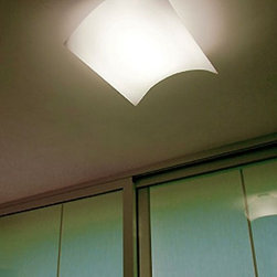 """Prandina - Prandina Light Volume ceiling light - The Light volume ceiling light by Prandina has been designed by BAKERYGROUP in 2004. This ceiling mounted luminaire is perfect for diffused fluorescent lighting. This fixture is made up of a matte white painted metal support. The diffuser is made-up of an opal polypropylene plate held by a white polyester microfiber removable and washable envelope. Built-in constant-output. Electronic gear in order to make this fixture dimmable is available upon request.  Product description: The Light volume ceiling light by Prandina has been designed by BAKERYGROUP in 2004. This ceiling mounted luminaire is perfect for diffused fluorescent lighting. This fixture is made up of a matte white painted metal support. The diffuser is made-up of an opal polypropylene plate held by a white polyester microfiber removable and washable envelope. Built-in constant-output. Electronic gear in order to make this fixture dimmable is available upon request. Details:                         Manufacturer:            Prandina                                    Designer:                         BAKERYGROUP                                         Made in:            Italy                            Dimensions:                        C21 Small: Height: 21.3"""" (54 cm) X Width: 11.8"""" (30 cm)                          C22 Medium: Height: 21.3"""" (54 cm) X Width: 23.6"""" (60 cm)                          C23 Large: Height: 21.3"""" (54 cm) X Width: 35.4"""" (90 cm)                                                                                                                                          Light bulb::                        Small: 1 x 26W fluorescent             Medium: 1 x 36W fluorescent             Large: 1 x 55W fluorescent                                         Material:            Premium metal, Polyester microfiber"""