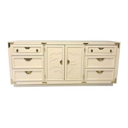 White Asian-Inspired Lacquered Dresser - A beautiful Asian-inspired dresser with gorgeous original brass Greek key hardware. The dresser has been newly lacquered in a high-gloss off-white. It features six outer drawers and two doors open up to three inner drawers. The piece is marked, Vaughan of Virgina. This piece would be great in any room as a dresser, media cabinet, or buffet cabinet.