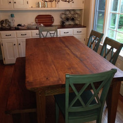 Farm Table and Bench - This dining area is complete with an all stain, rustic farm table made of reclaimed pine. Legs on both the table and the bench have a 2-sided taper.