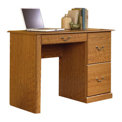 Sauder - Sauder Orchard Hills Small Wood Computer Desk in Carolina Oak finish - Sauder - Computer Desks - 401562 - This desk has a large drawer/shelf with metal runners and safety stops features flip-down panel for keyboard/mouse. Two drawers with patented T-lock assembly system hold letter-size hanging files. This computer desk has finely detailed moldings raised panel doors and brass-finish hardware. Carolina Oak finish makes this group the perfect accompaniment to the existing decor of any home or small office. A sensible combination of pull-out drawers and shelves digital media storage with adjustable shelving cubbyhole compartments and right-sized openings for electronic components reflect thoughtful design and enduring quality.