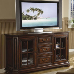 Riverside Furniture - Cantata 61 in. High Waist TV Console - Includes tip restraining hardware. Two wood-framed doors with glass insert. Behind decorative cross mullion overlay. One adjustable center shelf. Both doors double-hinged for full access to interior. Left door has bottom pull-out shelf. Right door has bottom fixed shelf. Top and center drawer. Felt-lined bottoms. Bottom drawer has game controller storage box mounted on back of drop-front face. Double-electrical outlet mounted in back of bottom drawer for powering up gaming consoles. Bottom drawer with wiring access hole in drawer back. Drawer constructed with dovetail joinery. Mounted on ball-bearing full-extension guides. Cutout in back panel for easy access. Base leveler. Bun feet. CPSC HR-4040 certified. Made from poplar hardwood solid, cherry and birch veneer. Burnished cherry finish. 61.5 in. W x 20.5 in. D x 34 in. H (182 lbs.). Assembly InstructionsWith a traditional appeal and superb craftsmanship, our Cantata theater collection adds style and comfort to your entertainment possibilities.