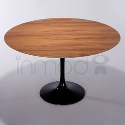 Saarinen Round Dining Table - Wood Top - The Saarinen Round Dining Table adds a unique accent to your home with its fun retro look. Inspired by the work of Eero Saarinen, this table's look will be recognizable to many. It is a high quality reproduction of Saarinen's Round Dining Table, part of his iconic Pedestal Collection.
