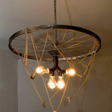 Eco Friendly Furnture and Lighting - Unique chandelier hand-crafted using recycled and restored bike parts, Victorian style Edison bulbs, elegant hanging chains, and washers. An eighteen foot wire makes it possible to hang and plug in almost anywhere. The diameter of the wheel is 25 inches. The fixture creates a warm, amber light.