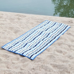 Nautical Stripe Quilted Beach Mats - Save the beach towels for swimming, the Nautical Stripe Quilted Fabric Beach Mats are what you need to lounge on the beach in style and comfort. This oversized mat has a comfortable, quilted top of weather-proof polyester in a nautical blues and white striped pattern. When you're done for the day, simply roll this mat up and the attached loops make it a breeze to carry.