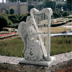 Design Toscano - Design Toscano Music from Heaven Angel Garden Statue - NG29970 - Shop for Statues and Sculptures from Hayneedle.com! The heavenly beauty of the Music from Heaven Angel Garden Statue adds a classic elegance to any garden or yard. This lovely piece is crafted from high-quality resin and given a realistic stone finish. It features amazing details and depicts an angel with her harp.About Design Toscano: Design Toscano is the country's premier source for statues and other historical and antique replicas which are available through our catalog and website.We were named in Inc. magazine's list of the 500 fastest growing privately-held companies for three consecutive years - an honor unprecedented among catalogers.Our founders Michael and Marilyn Stopka created Design Toscano in 1990. While on a trip to Paris the Stopkas first saw the marvelous carvings of gargoyles and water spouts at the Notre Dame Cathedral. Inspired by the beauty and mystery of these pieces they decided to introduce the world of medieval gargoyles to America in 1993. On a later trip to Albi France the Stopkas had the pleasure of being exposed to the world of Jacquard tapestries that they added quickly to the growing catalog. Since then our product line has grown to include Egyptian Medieval and other period pieces that are now among the current favorites of Design Toscano customers along with an extensive collection of garden fountains statuary authentic canvas replicas of oil painting masterpieces and other antique art reproductions.At Design Toscano we pride ourselves on attention to detail by traveling directly to the source for all historical replicas. Over 90% of our catalog offerings are exclusive to the Design Toscano brand allowing us to present unusual decorative items unavailable elsewhere. Our attention to detail extends throughout the company especially in the areas of customer service and shipping.
