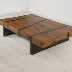 Digby Beam Table - This low coffee table is made from the structural beams that frame boat hulls. They are impossibly strong, beautifully weathered, and impressively solid. The beams are framed by inset blackened metal strapping. Each piece is completely unique due to a mix of wood types and bolt holes from each ship's construction. Available in light, medium or dark woods.