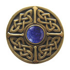 "Inviting Home - Celtic Knob (antique brass with blue sodalite) - Celtic Knob in antique brass with blue sodalite semi-precious stone 1-3/8"" diameter Product Specification: Made in the USA. Fine-art foundry hand-pours and hand finished hardware knobs and pulls using Old World methods. Lifetime guaranteed against flaws in craftsmanship. Exceptional clarity of details and depth of relief. All knobs and pulls are hand cast from solid fine pewter or solid bronze. The term antique refers to special methods of treating metal so there is contrast between relief and recessed areas. Knobs and Pulls are lacquered to protect the finish. Alternate finished are available. Blue Sodalite Semi-Precious stone. Blue Sodalite is a royal blue colored stone that usually has some white or gray-colored streaks. Blue Sodalite looks a bit more crystal-like. It was named by Professor Thomas Thompson who was called in to identify the specimen that was brought from Greenland to Denmark during the time of the Napoleonic wars - he identified it at first as Sodium Aluminum Silicate Chloride. The stone is associated with the Astrological sign Sagittarius and is thought to promote focus clearing mediation and calming of fears."