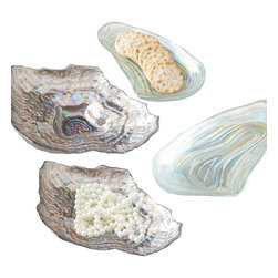 Sea Glass Set of 4 Lustrous Shell Plates - An exotic alternative to boring appetizer plates and conventional condiment dishes, or a glamorous oceanic arrangement for holding jewelry and countertop necessities, these versatile, food-safe Lustrous Shell Plates are made from luminous layers of sea-colored glass to replicate the natural loveliness of a perfectly-preserved shell. Two each of the Oyster and Clam designs make up the Sea Glass Set.