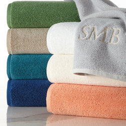"""SFERRA - Tub Mat - WHITE (TUB MAT) - SFERRATub MatDetailsLow-twist combed Turkish cotton terry.650 GSM.Ultra-absorbent.20"""" x 35"""".Machine wash.Made in Turkey.Designer About Sferra:The story of Sferra begins at the turn of the 19th century when Gennaro Sferra left Italy for the United States in the hopes of finding a market among the Atlantic Coast for his intricate Venetian lace cuffs and collars. By 1912 he and his family had opened up shop on famed Fifth Avenue in New York City. A generation later Gennaro's two sons expanded their family's collection to include the most luxurious European linens of the day from renowned double damask from Ireland to Alençon laces from France to elaborate embroideries from Belgium and Switzerland. In 1977 the ownership of Sferra was sold by the family to Paul Hooker under whose keen business savvy and passionate stewardship this classic brand has flourished over the years. With the aid of great advancements in design and production techniques Sferra has secured its rightful position as a leader in the luxury linens industry. Above all the secret to the enduring reputation of the Sferra brand is the same now as it was a century ago only the finest materials are used in any product bearing the Sferra name."""