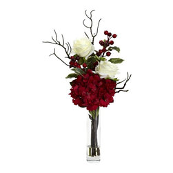 Merry Christmas Rose Hydrangea Arrangement - Holiday elegance in a glass vase - That's exactly what this beautiful Hydrangea, Rose and Berries arrangement offers your home or office. Beautiful Hydrangea blooms, full roses, lush berries, and a few sprigs combine to create a warm, distinct holiday feel. Nestled comfortably in a glass vase (complete with Liquid Illusion faux water), this crisp arrangement will bring cheer to your holiday table for years to come.