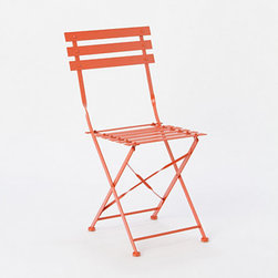 Painted Metal Bistro Chair, Red - Painted an eye-catching red, this metal bistro chair from Terrain is a similar take on the Arc en Ciel and is refreshingly cheery.