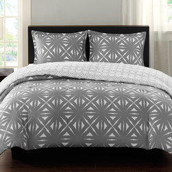 Echo - Echo Lattice Geo Reversible Comforter Mini Set - For a bold contemporary design the Echo Lattice Geo reversible comforter mini set is the perfect look. The comforter features a grey and white geometric inspired lattice print. It is fully reversible so you can easily change the look of your room. The comforter and sham reverses to a smaller scale lattice print for a more subtle design. Made from 100% cotton sateen, this comforter is machine washable for easy care. The set includes 1 sham. Comforter and sham: T210 cotton sateen Filling: 100% polyester