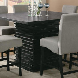 Coaster - Stanton Counter Height Dining Table - Stools sold separately. Contemporary style. Square smooth table top. Straight edges. Single pedestal unique trendy base. Made from wood solids and ash veneers. Black finish. 54 in. L x 54 in. W x 36 in. H. WarrantyRedefine your casual dining room with this modern counter height dining table.