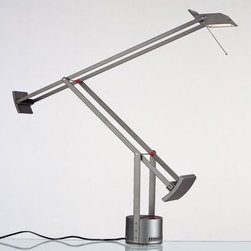 Artemide - Tizio Classic Desk Lamp - The Tizio Classic Table Lamp features fully adjustable arms in anti corrosion treated aluminum.  Arm spacer bars in chromed steel with red, molded thermoplastic insulators and counterweights in zinc alloy.  Adjustable diffuser in die-cast aluminum with inner high efficiency reflector in anodized aluminum with UV protective glass.  360 degree rotatable base in die-cast aluminum with incorporated low voltage transformer and two intensity on/off switch.  Available in Black, White or Silver Grey finish.  Tizio Classic LED available in Black finish only.  Tizio Classic lamp is 26 inches high x 30.75 inches deep x 46 7/8 inch maximum arm extension.  Includes one 50 watt GY6.35 halogen lamp.  UL listed.