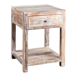 C.G. Sparks - 1-Drawer Stripped Teak Side Table - A stylishly subdued nightstand that easily doubles as a unique side table set alongside a sofa. Each nightstand is hand-crafted from salvaged wood timbers that feature paint remnants from their original use and a white-washed finish, meaning each table is distinct and rich in character. The reclaimed teak used to hand-build our furniture originates from bridges, homes and other buildings throughout India, most dating back to the colonial era, and was salvaged prior to demolition of the structure. During the salvaging process, nails or bolts are removed from the naturally durable wood, and any large holes are patched with smaller wood pieces. Knotholes, slight cracks and indentations can be expected and do not compromise the piece's structural integrity, but rather add character to the design. Due to the construction process and materials, slight variations that enhance the piece's character should be expected.