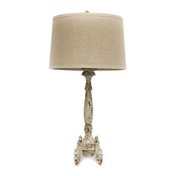 Swedish Candle Lamp - The slim spindle that makes up the Swedish Candle Lamp's base is a classic, but this traditional table lamp shows crafted detail that adds intrigue and combines with the pale, antiqued artisan finish to create unusual refinement. The baluster spindle rests in ornate legs that form a neat pedestal and a fine finish to the European lines of this perfect task-lighting option, while a coordinated finial secures the natural linen drum shade.